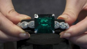 A model poses with a 38.51-carat Colombian emerald and diamond bangle, designed by Etcetera, the largest no oil emerald ever to be auctioned, at a preview by Christie's ahead of their jewelry sale in Hong Kong, China May 19, 2015. According to the company, the diamond bangle is worth an estimated value of $1.5 to $2.3 million and will be sold at the auction on June 2.