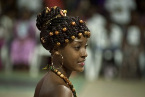 "A woman presents an Afro-Colombian hairstyle during the 10th contest of Afro-hairdressers ""Tejiendo Esperanzas"", on June 1, 2014, in Cali, Valle del Cauca department, Colombia. At the time of the colony, Afro hairstyles hid -on their design- the path that led to the freedom of the slaves. AFP PHOTO/Luis ROBAYO"